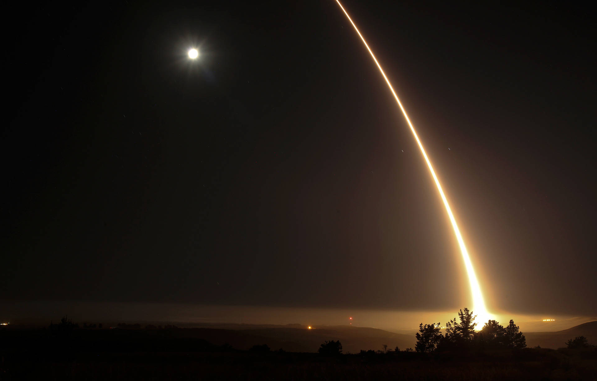 A streak of light trails off into the night sky during a test firing of an unarmed ICBM at Vandenberg Air Force Base early on May 3, 2017. The upcoming test will be the fourth such test this year. RINGO CHIU/AFP/Getty Images