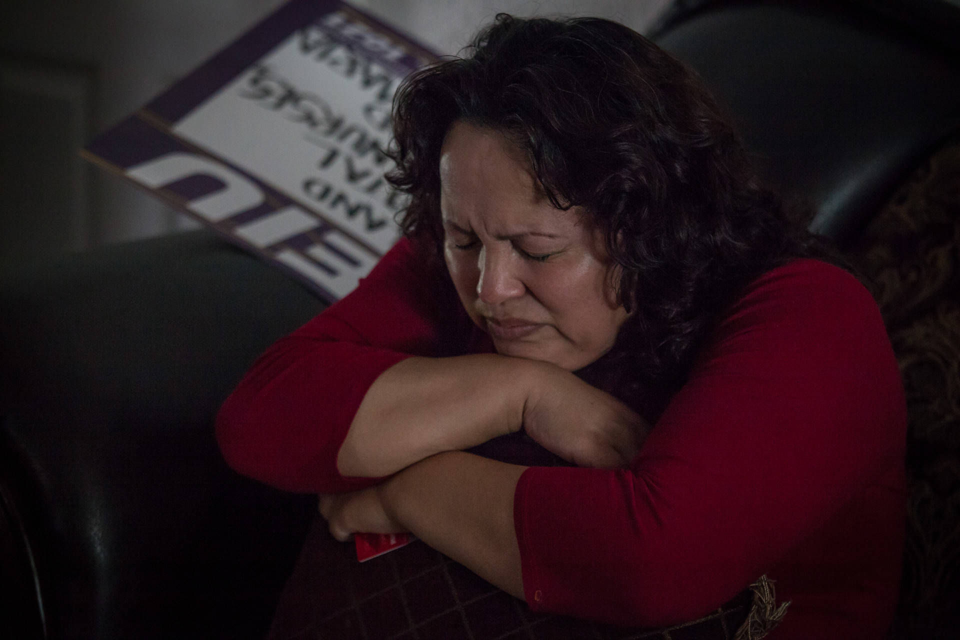Maria Mendoza-Sanchez clutches a pillow in her Oakland home on Wednesday, Aug. 16, 2017, hours before she, her husband and their son left the U.S. for Mexico after federal immigration authorities denied their request for a reprieve.  Deborah Svoboda/KQED