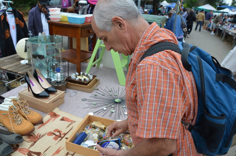 Alan Rosenzweig looks through a box of buttons at a flea market on Sunday, Aug. 6, 2017. Rosenzweig goes to at least one and often two flea markets every Sunday to add to his button collection.