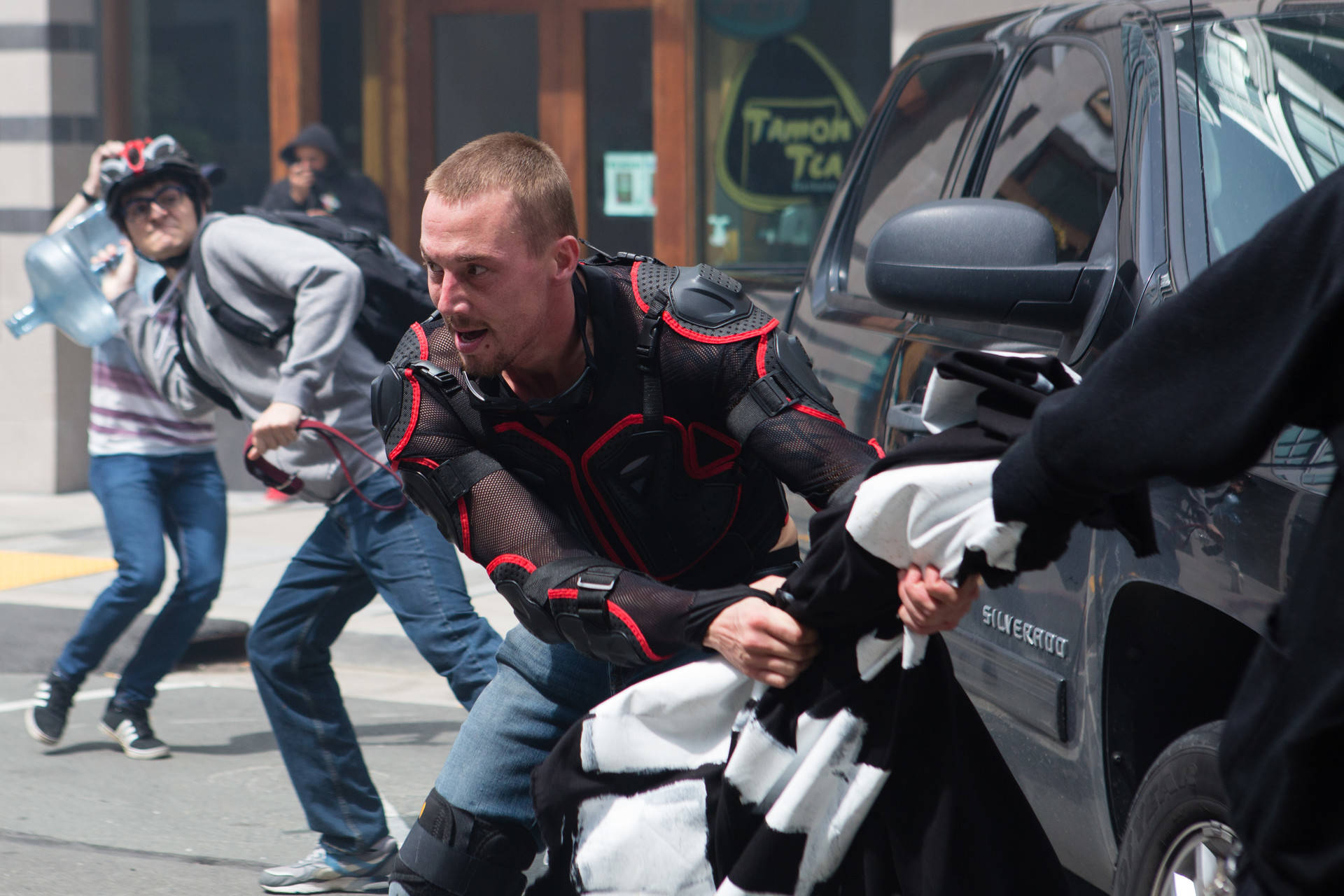 Right-wing activists fight counterprotesters in downtown Berkeley on April 15, 2017. Although police had the rally cordoned off early in the day, they withdrew after tensions escalated into violence, allowing both sides to engage in a running battle that left at least 11 people injured. Bert Johnson/KQED