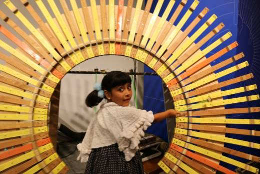 Lily Gutierrez plays an instrument at the Sound Museum.