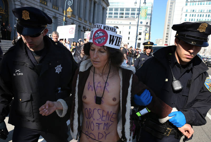 Nude activist Gypsy Taub is arrested by San Francisco police officers as he protests San Francisco's new ban on nudity at San Francisco City Hall on February 1, 2013.
