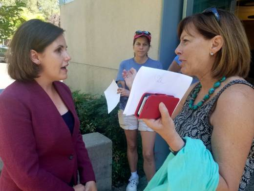 Democratic congressional candidate Regina Bateson (L) speaks with local resident Paige Stauss outside a public library in Granite Bay, following a campaign event.