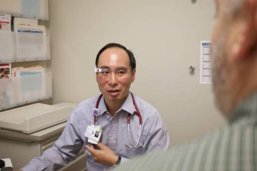 During patient exams, Dr. Albert Chan wears Google Glass, which transmits a video feed to a note-taking, offsite medical scribe so Chan can better focus on the patient.