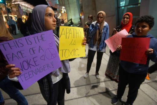 A group of Muslim protesters gather during a rally against an earlier version of Trump's travel ban at San Diego International Airport on March 6, 2017.