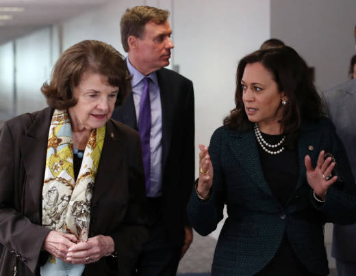 Senators Dianne Feinstein and Kamala Harris walk to a Senate Select Committee on Intelligence closed door meeting in April.