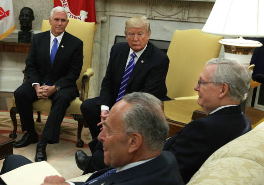 Clockwise from upper left, U.S. Vice President Mike Pence and President Donald Trump meet with Senate Majority Leader Mitch McConnell (R-KY), Senate Minority Leader Chuck Schumer (D-NY) and other congressional leaders in the Oval Office of the White House September 6, 2017 in Washington, DC.