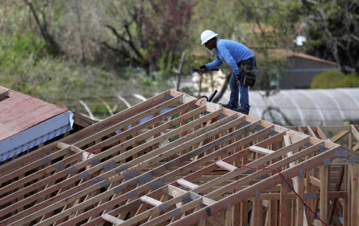 A construction worker builds a home in Petaluma in March, 2017.