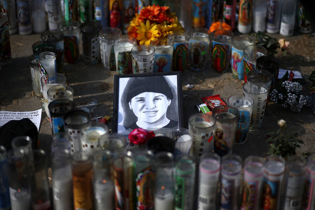 A picture of 13 year-old Andy Lopez sits with gifts and candles at a memorial on October 29, 2013 in Santa Rosa, California.