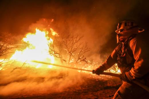 A firefighter battles the Blue Cut wildfire burning near Cajon Pass, north of San Bernardino, California on August 16, 2016. Fire officials say wildfires will continue to ravage California unless funds are dedicated to preventative efforts.