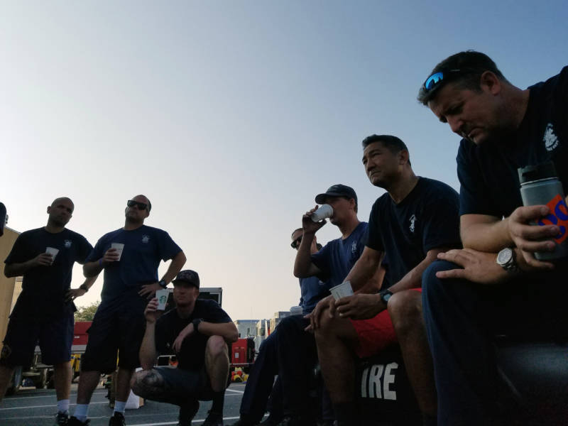 Members of the California Office of Emergency Services Swiftwater Flood Rescue Team 10 -- made up of firefighters from Ventura County -- listen to a briefing on Hurricane Harvey rescue operations in College Station, Texas on Sept. 2, 2017.