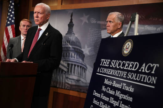 Sen. Orrin Hatch (R-UT) (2nd L) speaks as Sen. James Lankford (R-OK) (L) and Sen. Thom Tillis (R-ND) (R) listen during a news conference to announce the 'SUCCEED Act' September 25, 2017.