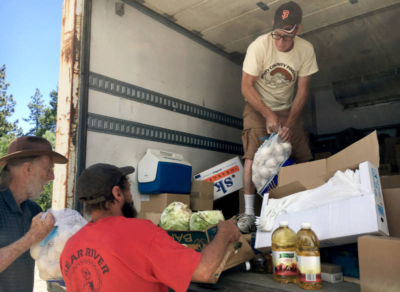 Jeff England, director of the Trinity County Food Bank, delivers items in remote Zenia, California. The closest large grocery store is 100 miles away.