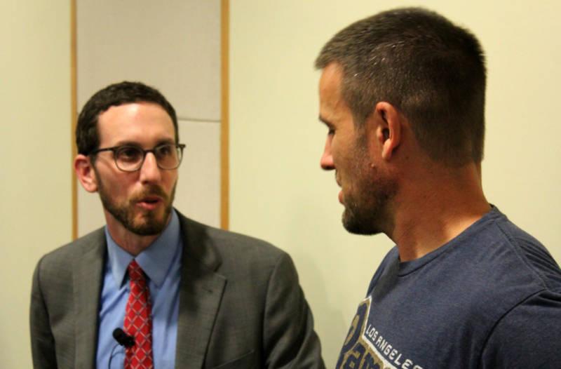 State Sen. Scott Wiener (D-San Francisco) speaks to an attendee at an Abundant Housing LA event.