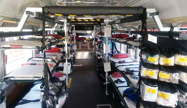 "In a regular ambulance, ""we would have cabinets where we could store all this equipment"" says Zanoff. Here, they use a system of pouches that hang by the backdoor of the bus."