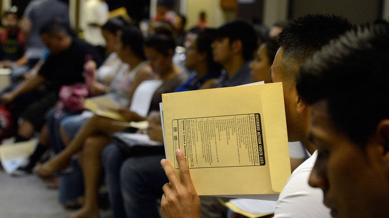 People attend an orientation class in filing out their application for Deferred Action for Childhood Arrivals program at Coalition for Humane Immigrant Rights of Los Angeles in August 2012 in Los Angeles.