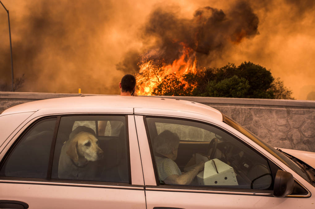 Residents of the community of Tujunga flee a fire near Burbank on Sept. 2. Even people much farther from the flames are feeling health effects from acrid smoke.