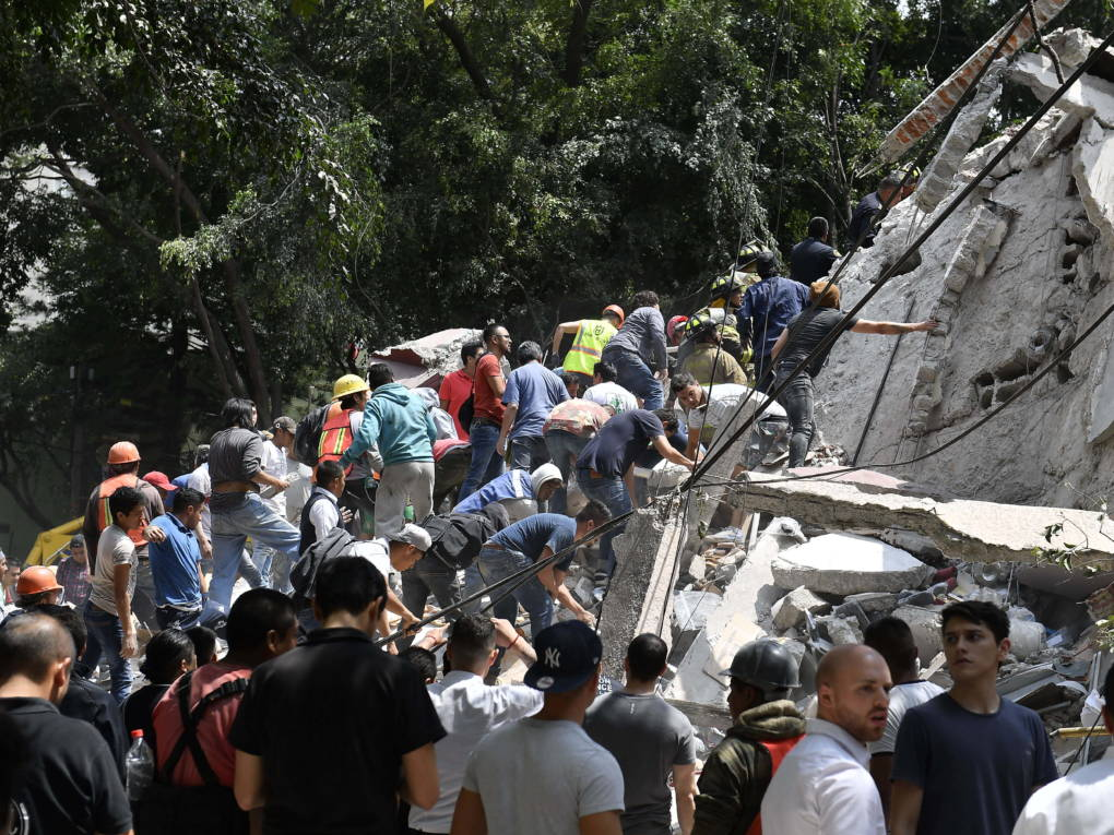 People remove the debris of a collapsed building looking for possible victims after the 7.1 magnitude quake rattled Mexico City on Tuesday.