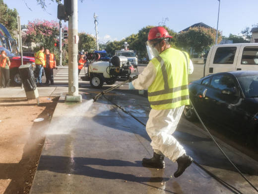 City workers wash down streets and sidewalks in an effort to control a Hepatitis A outbreak in San Diego on Monday.