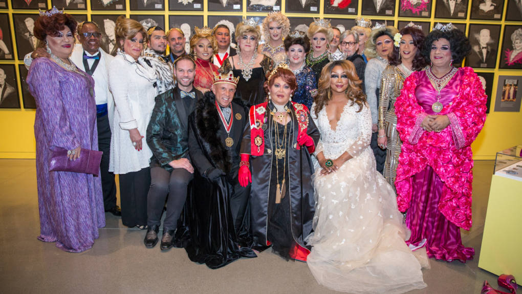 Members of the Imperial Court pose at an exhibition opening at the Oakland Museum of California.