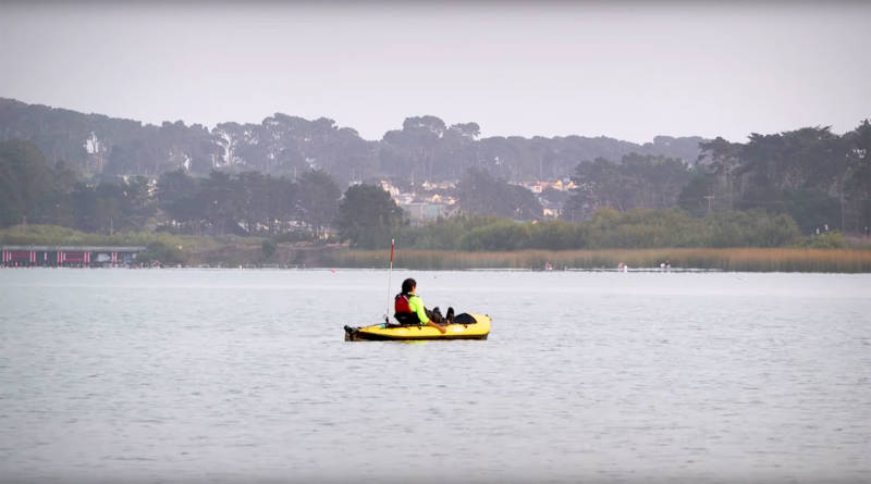 Ustunel paddles his kayak solo on San Francisco's Lake Merced.