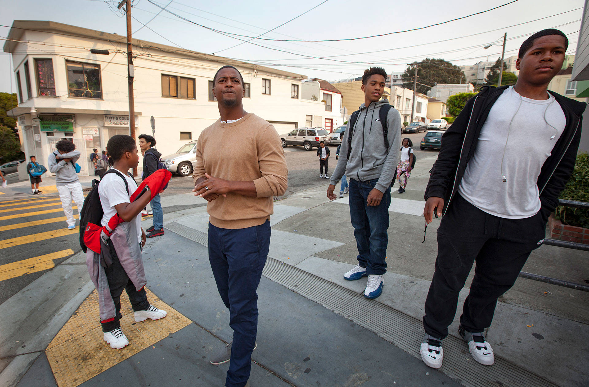 Principal Charleston Brown oversees dismissal at Willie L. Brown Jr. Middle School in San Francisco's Bayview neighborhood. His black students struggle to pass state tests in reading and math. Penni Gladstone/CALmatters