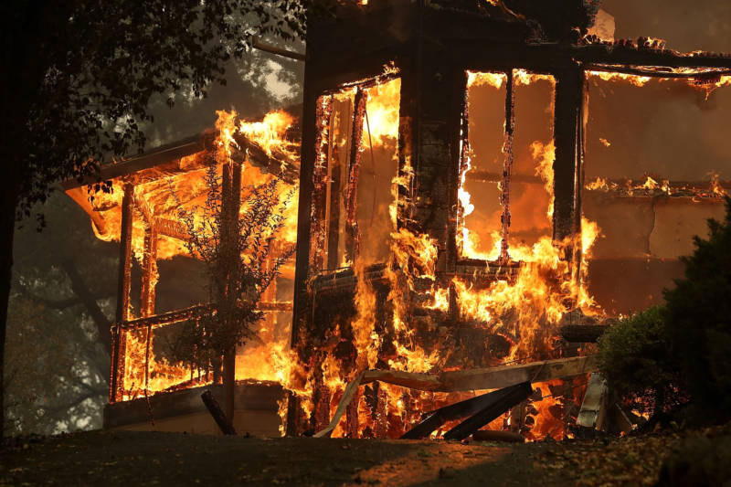 Flames consume a home as out-of-control wildfires move through the area on October 9, 2017 in Glen Ellen.