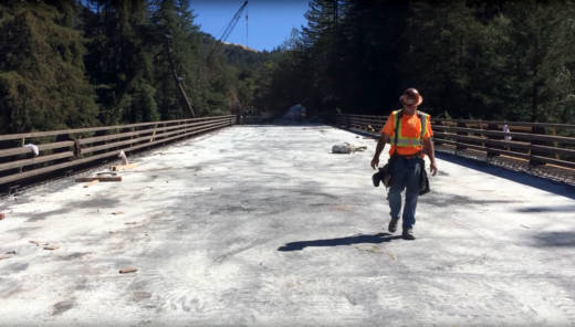 A worker walks across the brand new Pfeiffer Canyon Bridge in Big Sur before it opened.