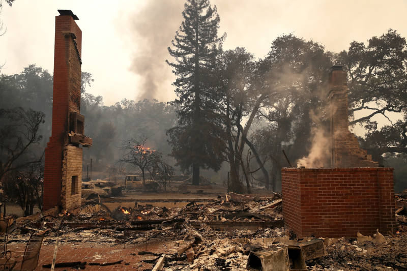 Remains of destroyed homes smolder in Glen Ellen on October 9, 2017. Tens of thousands of acres and dozens of homes and businesses have burned in a widespread wildfire that is burning in Napa and Sonoma counties.