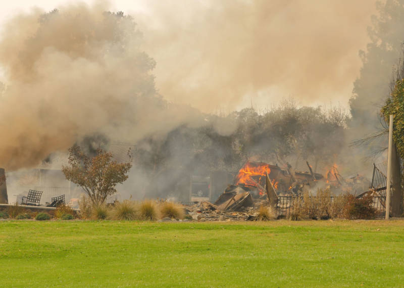 The remains of a home burn next to the golf course at the Silverado Resort and Spa in Napa.