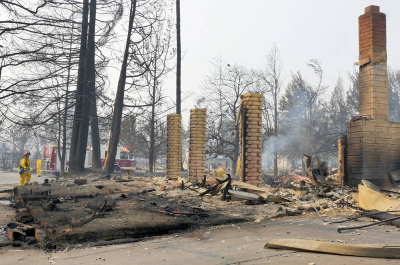 Firefighters work near burned homes and debris in Santa Rosa's Coffey Park subdivision.