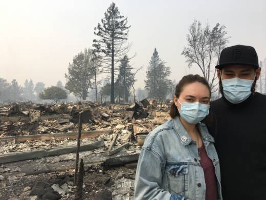 Kayla Swaim, 27, stands in front of what remains of the house in Santa Rosa she's lived in for her whole life. She lived with her boyfriend Juan Ferrel, who turned 27 on Tuesday.