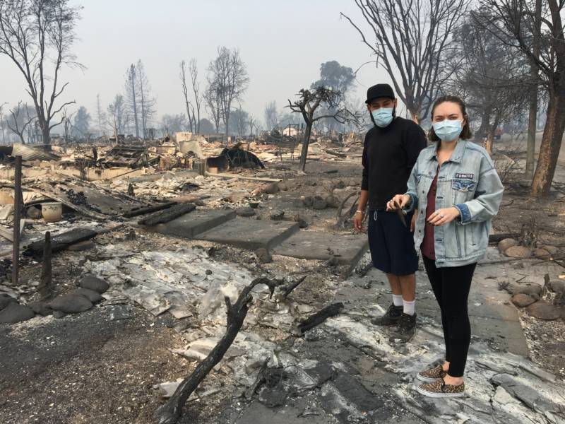 Kayla Swaim, 27, and Juan Ferrell, 27, look for mementos in the remains of their home in Santa Rosa.