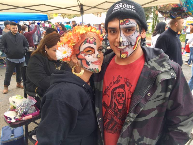 Jennifer Hale and Lorenzo Ortiz had their faces painted as Dia de los Muertos skulls. They were among the many young people at the festival.