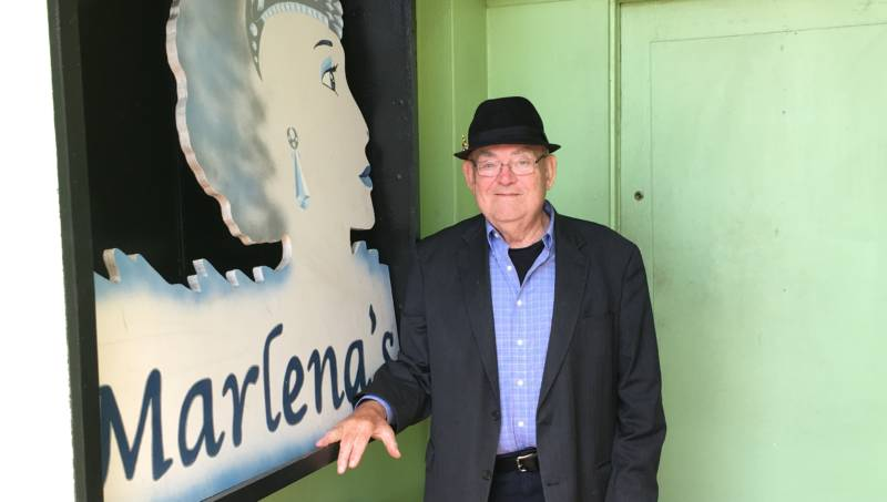 Empress Marlena (aka Gary Mclain) poses by the sign that used to hang above her bar. Marlena's was ground zero for the Imperial Court for close to three decades.
