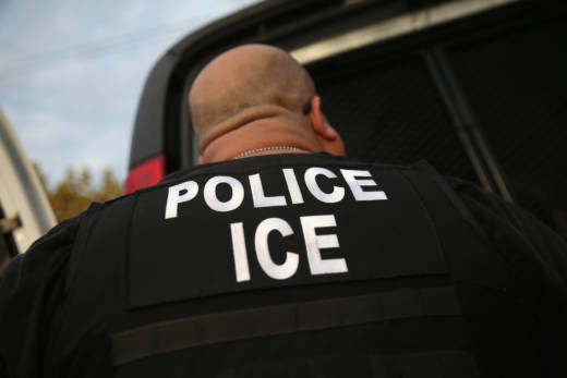 A U.S. Immigration and Customs Enforcement (ICE) agent detains an immigrant in Los Angeles in 2015.
