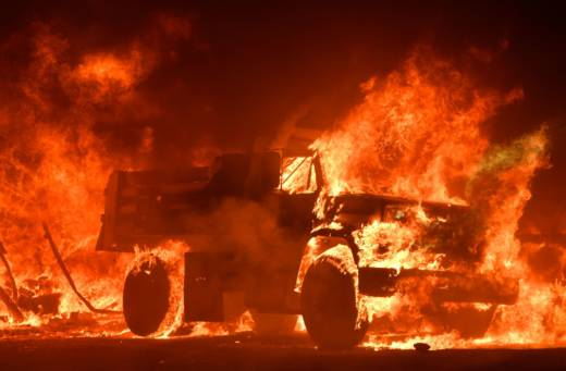 A truck burns as fire ravages the Napa wine region in California on October 9, 2017, as multiple wind-driven fires continue to whip through the region.