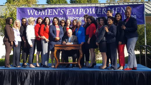 Governor Jerry Brown signs a package of bills surrounded by members of the California Legislative Women's Caucus.