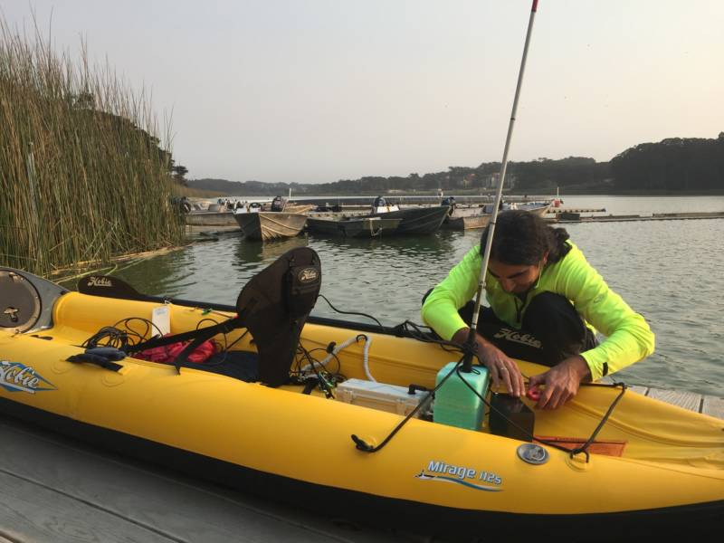 Ahmet Ustunel sets up his kayak with many gadgets to help him navigate the water. He attaches his white cane to his boat to indicate that he is blind.