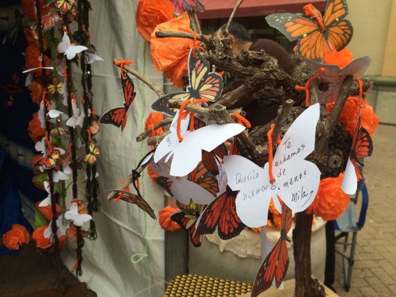 Artist Alicia Diaz included a tree of butterflies with the names of loved ones on her altar. Monarch butterflies are thought to help guide spirits home.