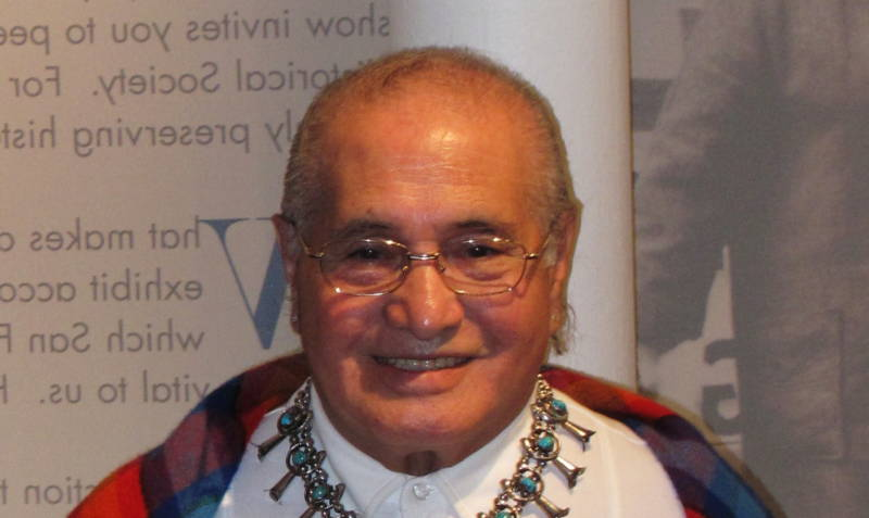 Jose Sarria posing during a visit to the GLBT Historical Society in 2009.