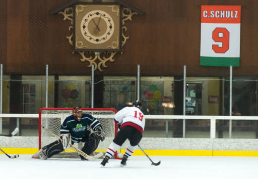 Charles Schulz's No. 9 jersey hangs from the rafters during a game of Snoopy's Senior World Hockey Tournament in 2015.