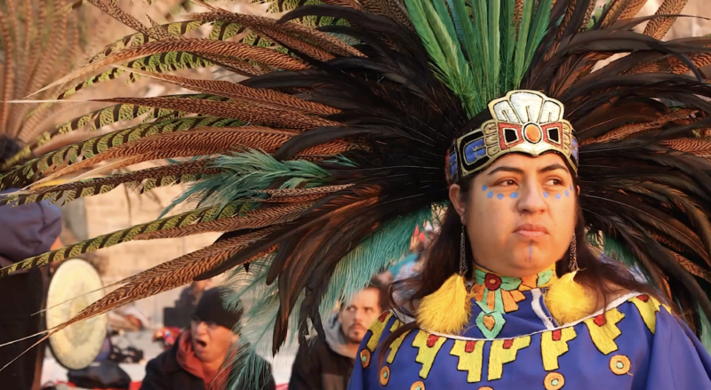 A participant of the Indigenous Peoples Day sunrise ceremony on Alcatraz Island prepares for a sacred dance.