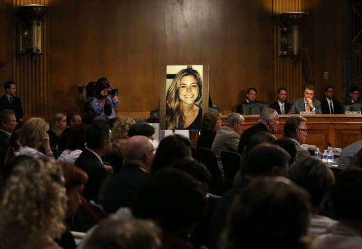 A large photo of Kathryn Steinle is shown while her dad, James Steinle, testifies during a Senate Judiciary Committee hearing on Capitol Hill, July 21, 2015, in Washington, D.C. The committee heard testimony from family members who have had loved ones killed by undocumented immigrants.