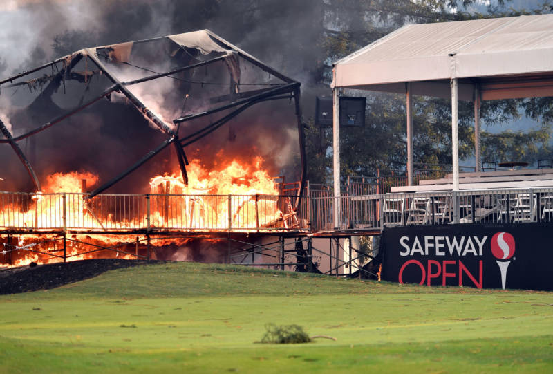 A tent structure built for the 2017 Safeway Open burns on a golf course at the Silverado Resort and Spa in Napa on October 9, 2017, as multiple wind-driven fires continue to whip through the region.