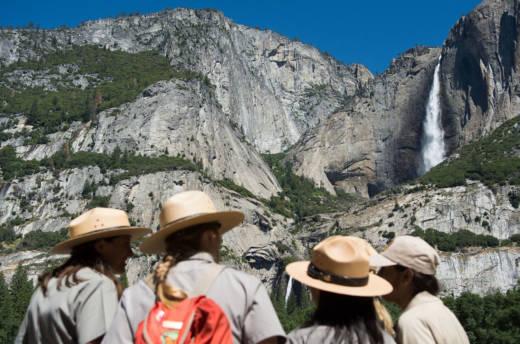 Park rangers meet in front of Yosemite Falls.