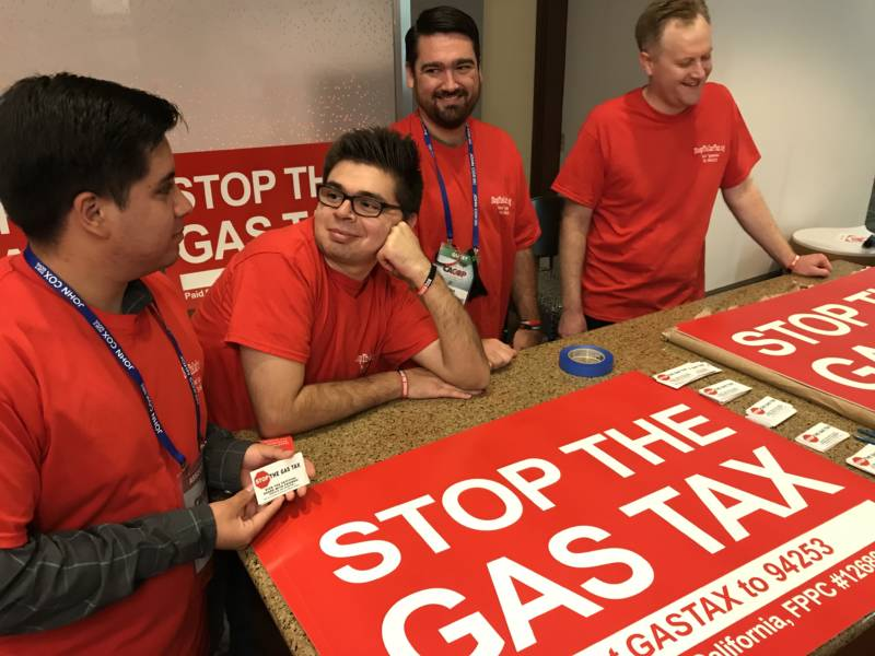 Volunteers at the GOP convention in Anaheim staff a table promoting a repeal of the recent gas tax increase.