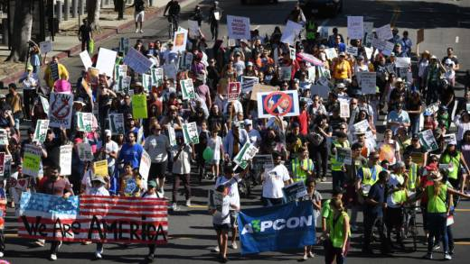 People march as they participate in the '#NoMuslimBanEver' rally in downtown Los Angeles on Sunday. The march organized by the Council on American-Islamic Relations was in response to President Trump's most recent travel ban, which has now been blocked by a federal judge in Hawaii.