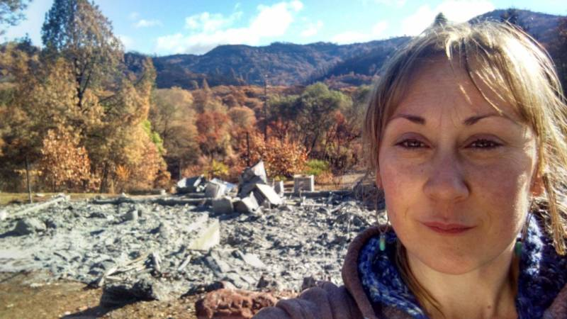 Elly Diaz in front of the ashes that remain of their family home in Redwood Valley, Mendocino.