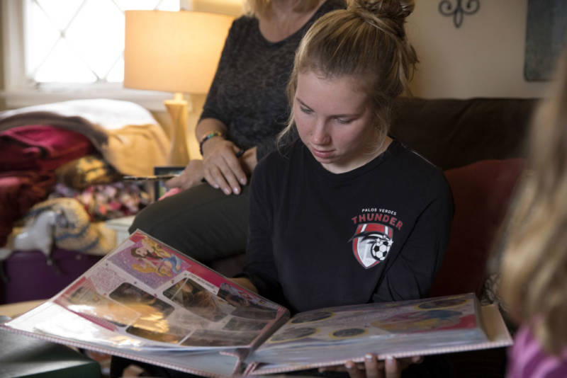 Amber Patterson looks at family photo albums at home in Lomita on Oct. 30, 2017.